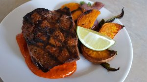 Sun Basket Grilled Steak with Roasted Poblanos and New Mexican Chile Sauce